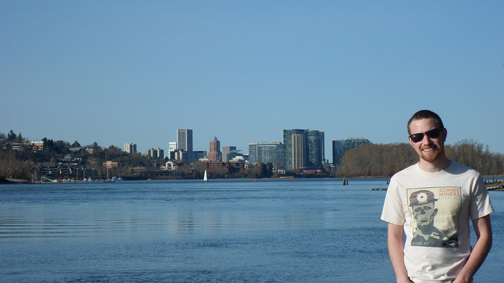 Photo of Author with the city of Portland in the background